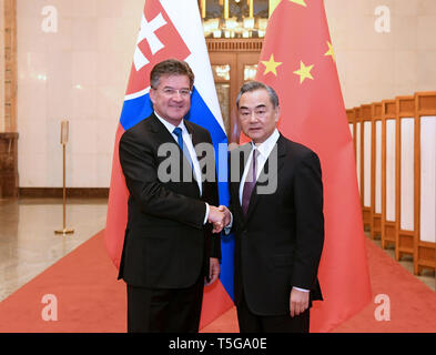 Beijing, China. 24th Apr, 2019. Chinese State Councilor and Foreign Minister Wang Yi (R) meets with Slovak Foreign Minister Miroslav Lajcak in Beijing, capital of China, April 24, 2019. Credit: Shen Hong/Xinhua/Alamy Live News - Stock Image