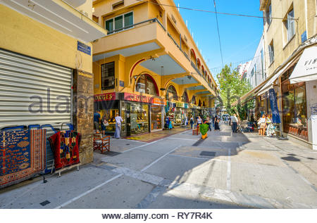 Tourists and local Greeks shop at the outdoor shopping center and marketplace near the Monastraki and Plaka district in Athens Greece - Stock Image
