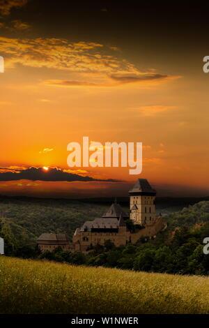 Karlstejn gothic castle near Prague on the sunset. - Stock Image