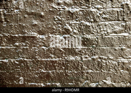 Brick wall painted with gold paint as a background for an advert in London UK . KATHY DEWITT - Stock Image