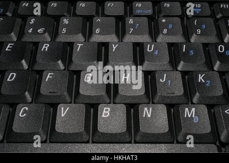 Black computer keyboard keys with white letters. - Stock Image