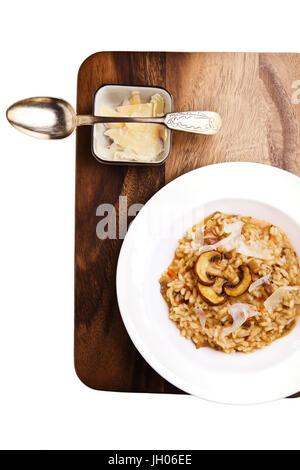 Mushroom risotto served on a table. Italian cuisine - Stock Image
