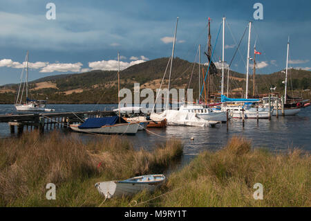 Boats moored in the Huon River at Franklin in the Channel Country of  southern Tasmania, Australia - Stock Image