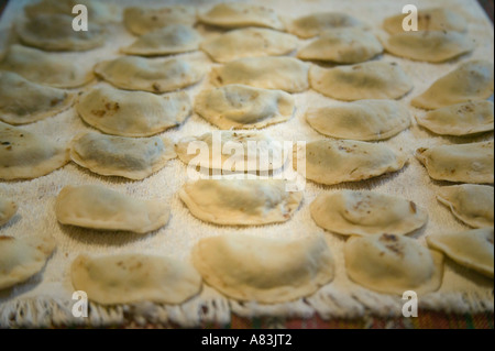 'Warenyky' or 'Pierogie' laid out on a sheet immediately after being rolled. - Stock Image