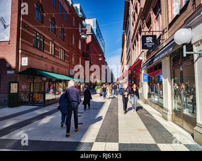 16 September 2018: Stockholm, Sweden - Shoppers in Drottninggatan on a bright sunny autumn weekend. - Stock Image