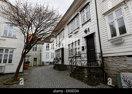 Street with wooden houses in the Bergen city center. - Stock Image