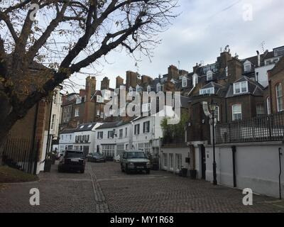 Classic mews in London where a row of houses have been converted from stables - Stock Image