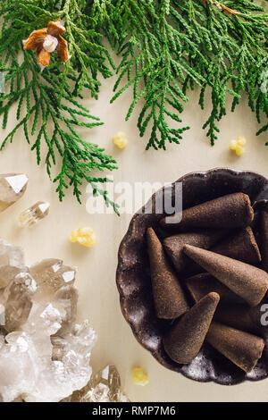 Incense Cones with Smoky Quartz and Incense Cedar - Stock Image