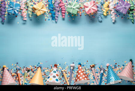 Birthday party decoration,streamers,hat and gift boxes - Stock Image
