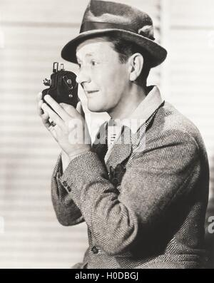 Man filming home movie - Stock Image