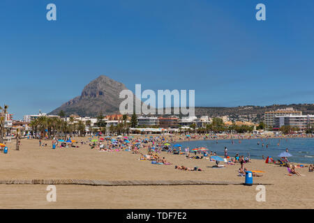 Xabia beach Spain Playa del Arenal in summer with blue sky and people, also known as Javea - Stock Image