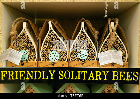 Garden Centre display of hanging bug houses to provide for conservation breeding hibernation and study of insects especially solitary bees. - Stock Image