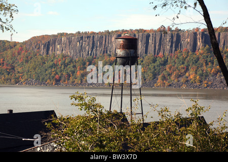 Old rusty water tower on the shores of the Hudson River, Hastings-On-Hudson, NY, USA - Stock Image