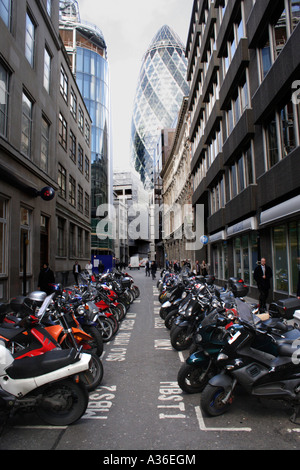 Swiss Re Tower and parked motorbikes London - Stock Image