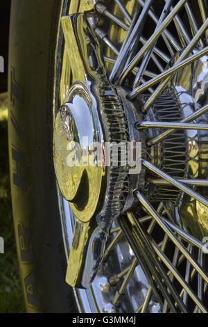 Westbury, New York, USA. June 12, 2016. Rudge-Whitworth, Milano, 52mm 72 spoke chrome wire wheel with 2-bar spinner - Stock Image