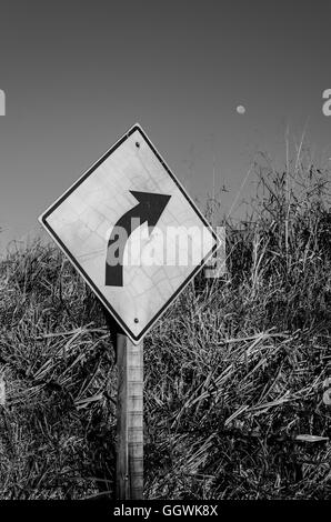 traffic direction sign pointing to the moon - Stock Image