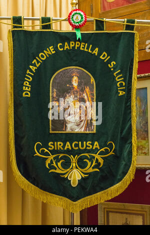 Italy Sicily Syracuse Siracusa Ortygia Baroque Duomo Templo di Minerva cathedral Saint Bishop Zosimo pennant green Deputazione Cappella di S Lucia - Stock Image
