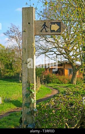 Wooden footpath fingerpost sign in field, Australia Lane, Grappenhall, Warrington, Cheshire, UK - Stock Image