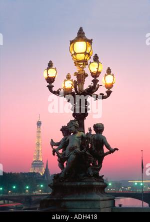 France Paris Pont Alexandre III Eiffel Tower Laterne angel sculptures - Stock Image