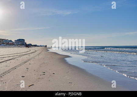 Sunrise or early morning on a white sand beach in the Florida or Alabama, USA, panhandle near Destin where families go for a vacation or on holiday. - Stock Image