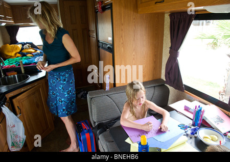 Children making drawings inside a camper campervan RV in Texas, USA - Stock Image