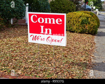Small yard or snipe sign for a business stating Come In, We're Open, found in Warm Springs Georgia, USA. - Stock Image