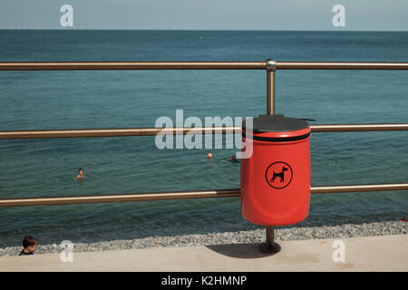 Dog waste bin on the seafront in Sheringham, North Norfolk, UK - Stock Image