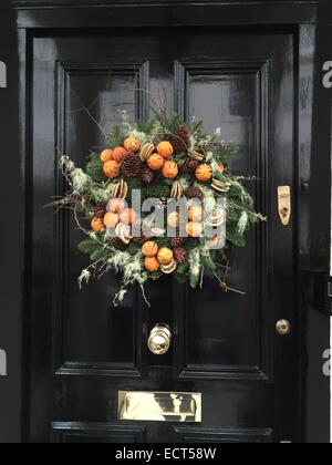 A Christmas decorative wreath on a door in Belgravia, London UK. - Stock Image