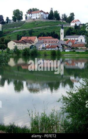Old town of Sevnica viewed over Sava river, Slovenia - Stock Image