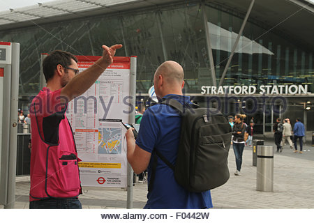 London, UK. 6th Aug, 2015.  Travel Ambassador advises commuter An extra 250 buses, including the older routemaster - Stock Image
