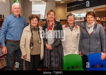 Bantry, West Cork, Ireland. 10th Apr, 2019. Novelist Breda Joy was in Bantry Library today, reading from her debut novel 'Eat The Moon'. Although Breda is still promoting the book, she has started work on her second book. Breda is pictured with some of her fans at the reading. Credit: Andy Gibson/Alamy Live News. - Stock Image