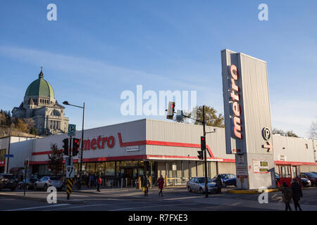 MONTREAL, CANADA - NOVEMBER 4, 2018: Metro logo, in front of their supermarket in northern Montreal, Quebec. Metro Inc. is the 3rd largest Canadian su - Stock Image