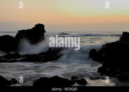 Sunrise photoshoot at Erma's Beach on the island of Oahu, Hawaii - Stock Image