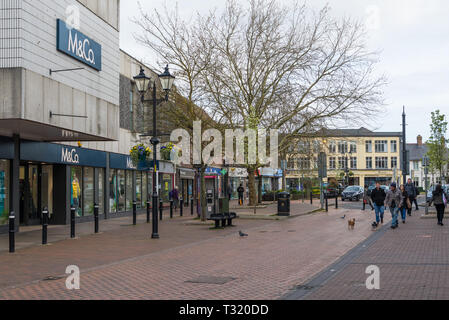 Early morning shoppers and dog walkers in the High Street, Chesham town centre, Bucks, England, UK - Stock Image