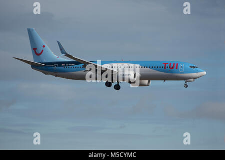 A Boeing 737-800 holiday flight returns to Aberdeen after the passengers had enjoyed a break in the Mediterranean - Stock Image
