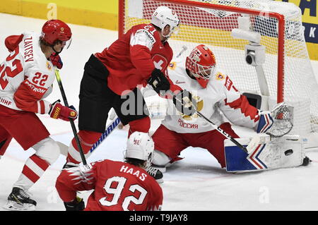 Bratislava, Slovakia. 19th May, 2019. L-R Nikita Zaitsev (RUS), Kevin Fiala (SUI), goaltender Alexandar Georgiyev (RUS) and Gaetan Haas (SUI), front, in action during the match between Switzerland and Russia within the 2019 IIHF World Championship in Bratislava, Slovakia, on May 19, 2019. Credit: Vit Simanek/CTK Photo/Alamy Live News - Stock Image