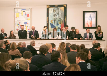 London UK. 19th June 2019. 'Sotheby's staff taking bids  for  L-R 'Relational Painting No 60 by Fritz Glamer, oil on canvas, Estimate £450,000 which sold at hammer for £620,000;'Homme a la pipe by Pablo Picasso, Estimate £5,500,000 m which sold at hammer for £6,500,000m; 'La magie noire, oil on canvas  by René Magritte, Estimate £2,500,000 which sold at hammer for £3,500,000 at the Impressionist & Modern Art Evening Auction  at Sotheby's London London Credit: amer ghazzal/Alamy Live News - Stock Image