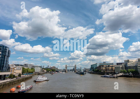 A view down The River Thames from London bridge looking towards Tower Bridge. - Stock Image