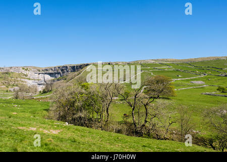 View across countryside to Malham Cove. Malham, Malhamdale, Yorkshire Dales National Park, North Yorkshire, England, - Stock Image
