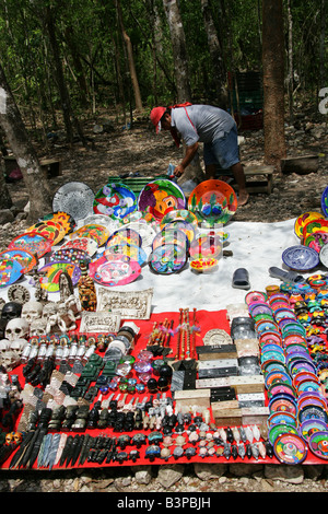 Man Selling Tourist Souveniers and Trinkets at Chichen Itza Archeological Site Yucatan Mexico - Stock Image