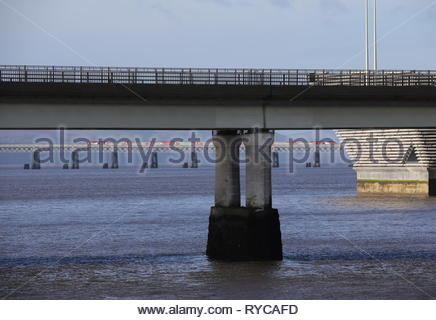 Tay Road Bridge and LNER train crossing Tay Rail Bridge Dundee Scotland  March 2019 - Stock Image