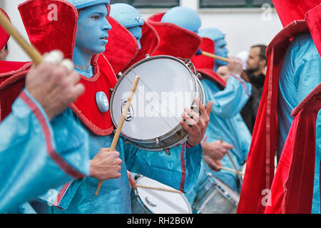 Samba percussion music band dressed in turquoise and red costumes- Mealhada Carnaval parade, Portugal - Stock Image