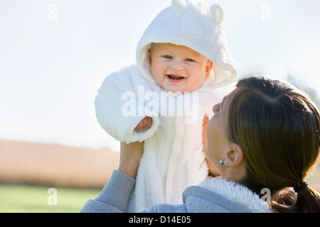 mother holding her baby - Stock Image