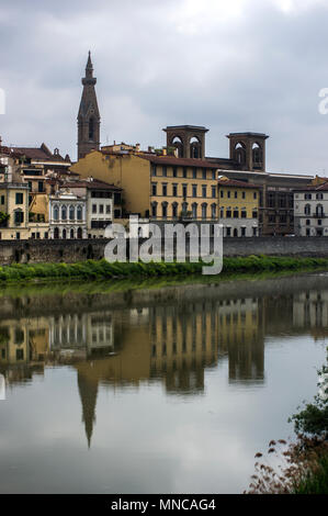 Buildings reflected in the river Arno in Florence Italy - Stock Image
