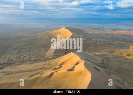 Aerial view of Singing Sand Dune (Barchan) in Altyn-Emel National Park, Kazakhstan - Stock Image