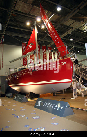 Bright red Southerly sailing yacth at  the london boat show - Stock Image