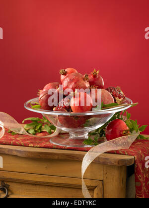 Pomegranates in Bowl on Table - Stock Image