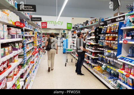 People shopping in Asda supermarket aisle, Asda, Bury St Edmunds, Suffolk UK - Stock Image