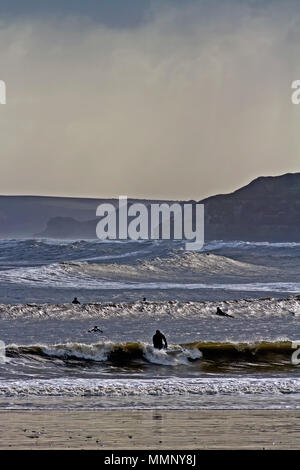 Surfers catching waves in Scarborough's South Bay. - Stock Image