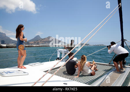 Visitors Sail on Catamaran in Table Bay in Cape Town - South Africa - Stock Image